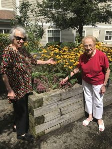 Women enjoying the garden at Tamarisk
